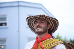 A man dressed up in traditional hispanic attire for the old spanish days fiesta